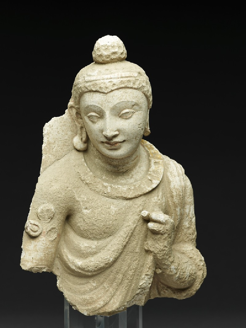 Figure of the Buddha or an attendant (side            )