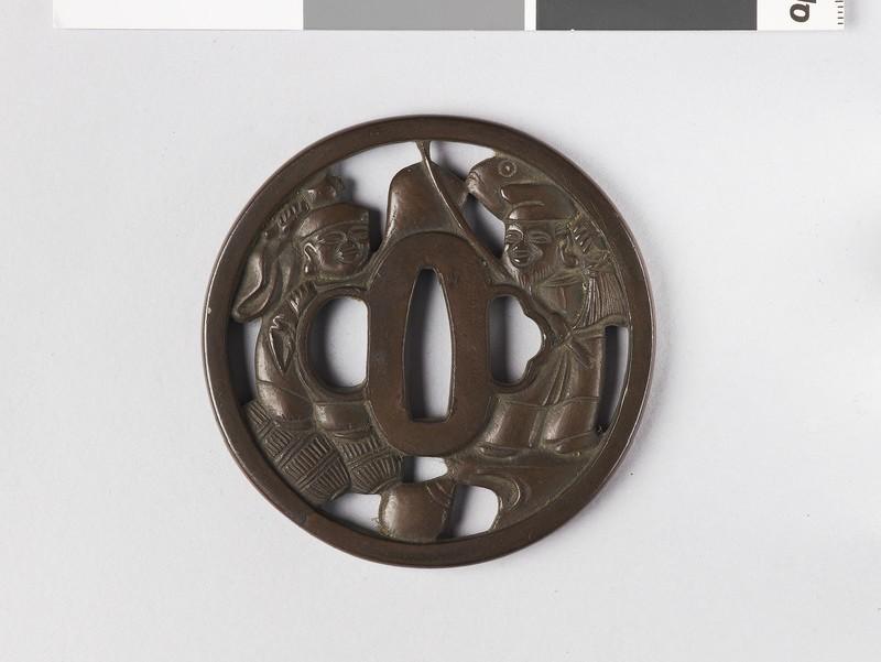 Round tsuba with Gods Ebisu and Daikoku (front           )