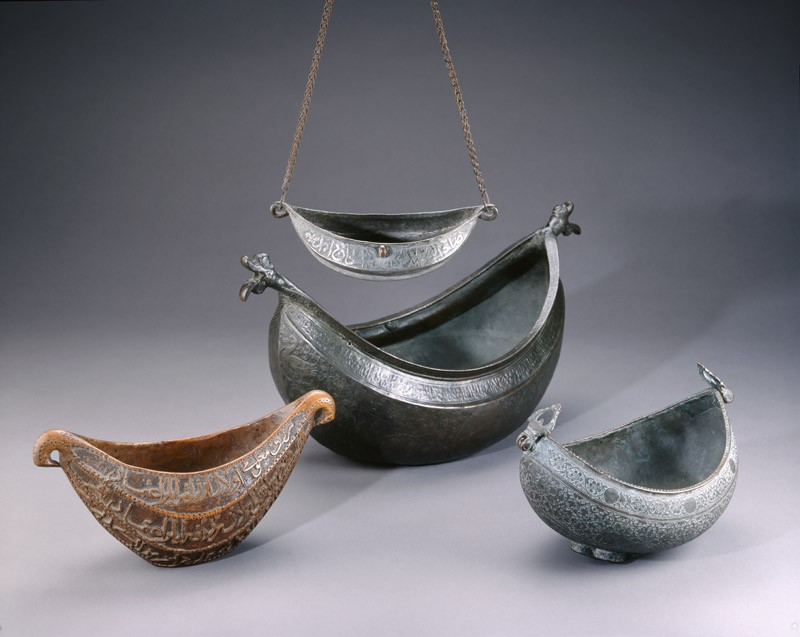 Kashkul, or begging bowl, in the form of a boat (EA1978.153, oblique with EA1959.10, EA1959.12 and EA1992.31            )