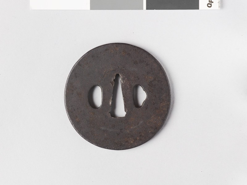 Round tsuba with plain design