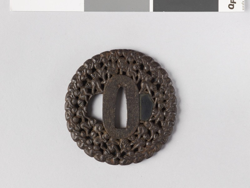 Round tsuba with design of The Hundred Monkeys (front            )