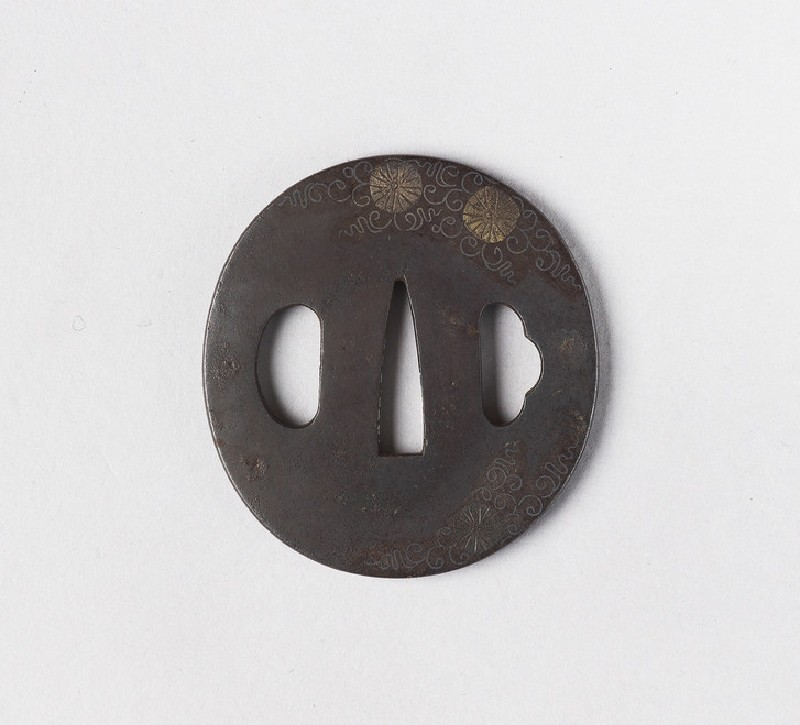 Round tsuba with design of tendrils and flowers