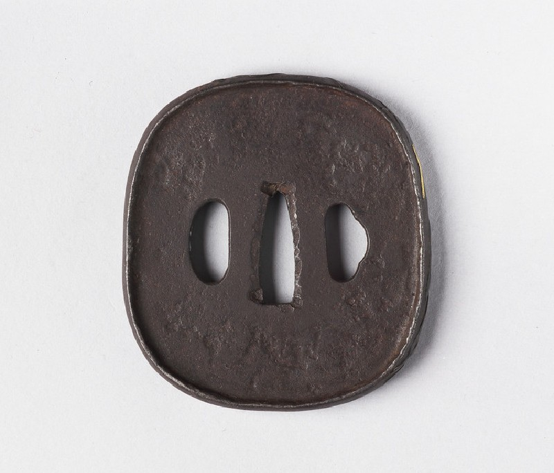 Round tsuba with design of bean and tendrils around edge