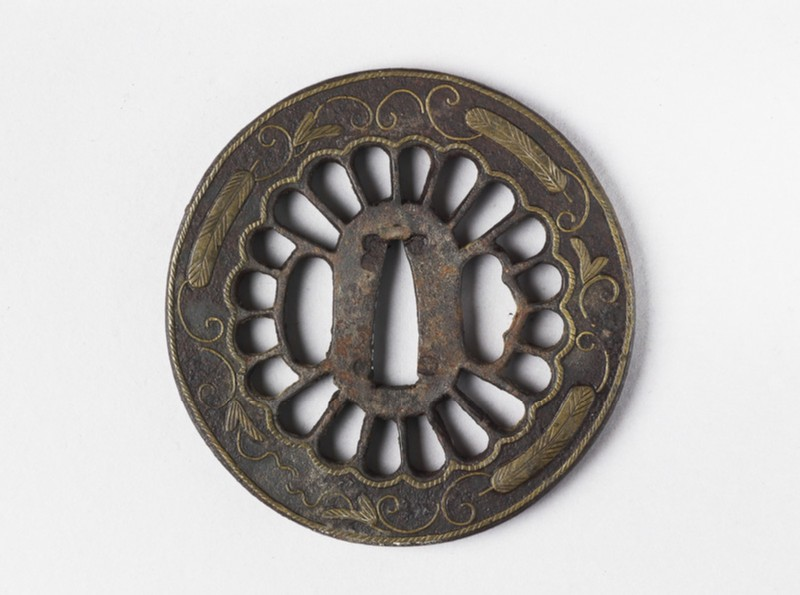 Round tsuba with design of rope, feathers and tendrils (EA1978.237, front            )