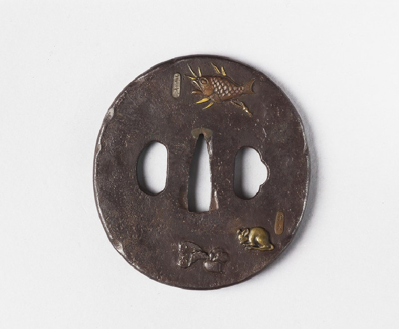 Round tsuba with design of carp, rat, radish and Daruma