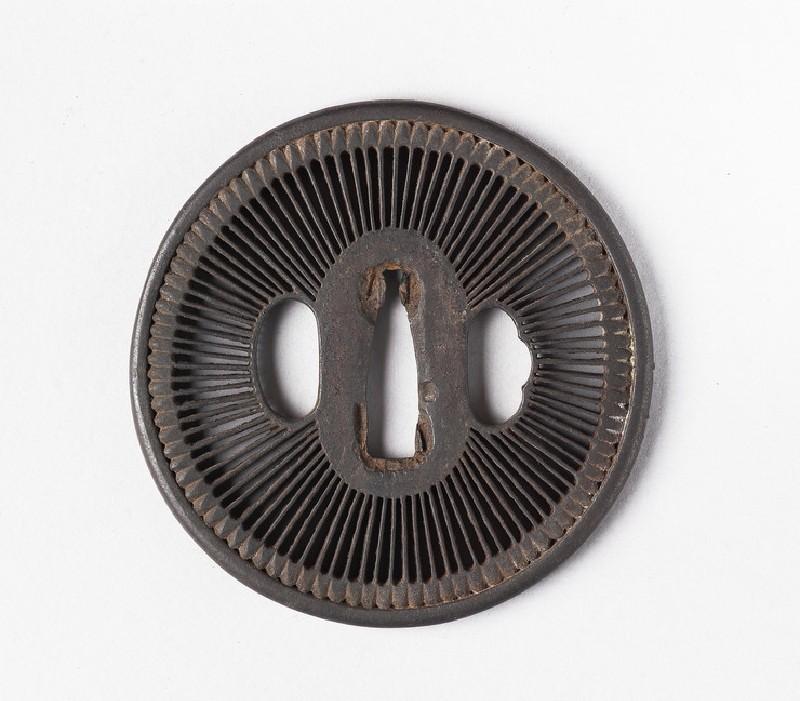 Round tsuba with design of amida-yasurime (radial striations)