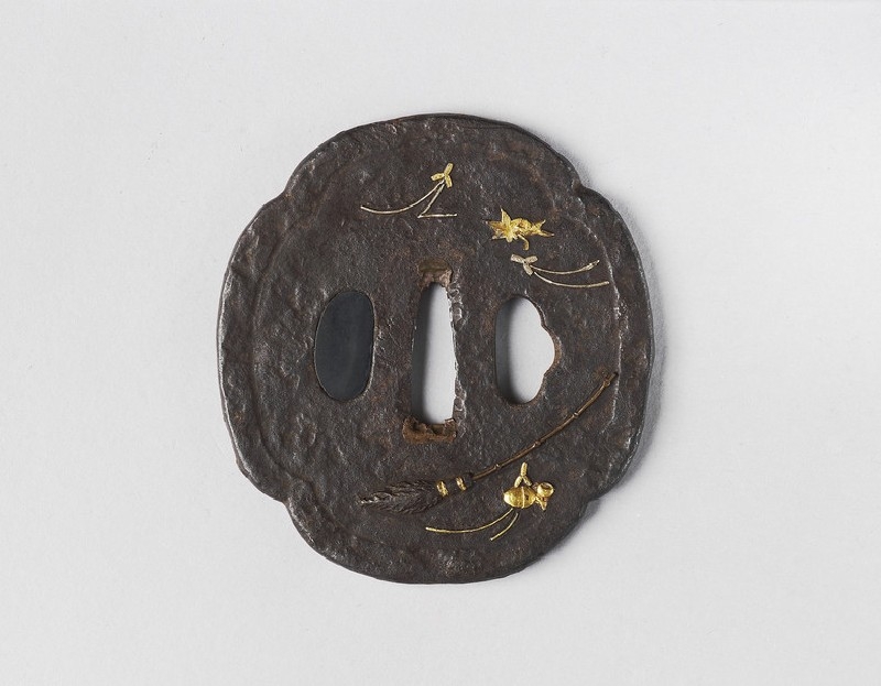 Mokkō-shaped tsuba with design of a broom, maple leaf, pine needles, and acorns (front            )