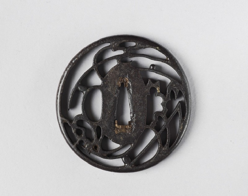 Round tsuba with design of cricket and grass (front            )