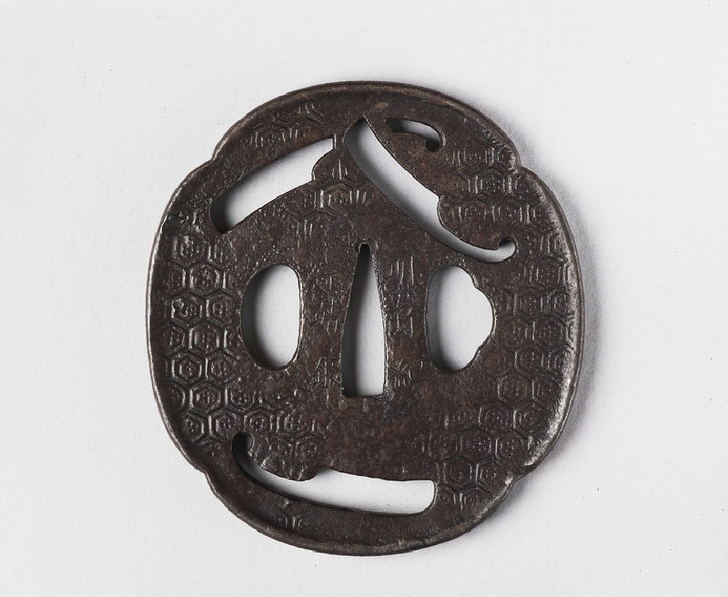 Mokkō-shaped tsuba with design of three nata (tools)