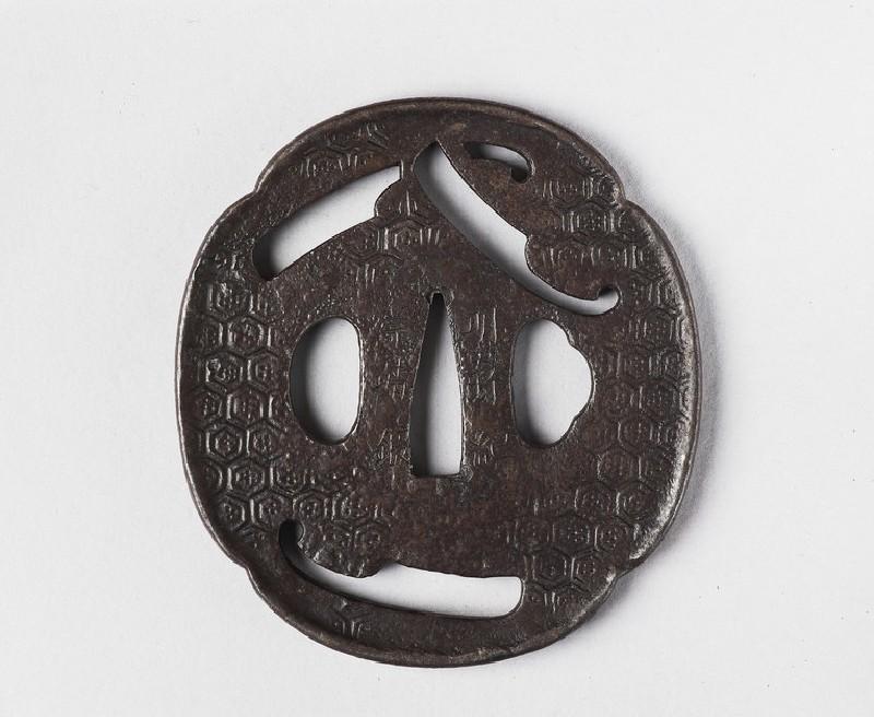 Mokkō-shaped tsuba with design of three nata (tools)