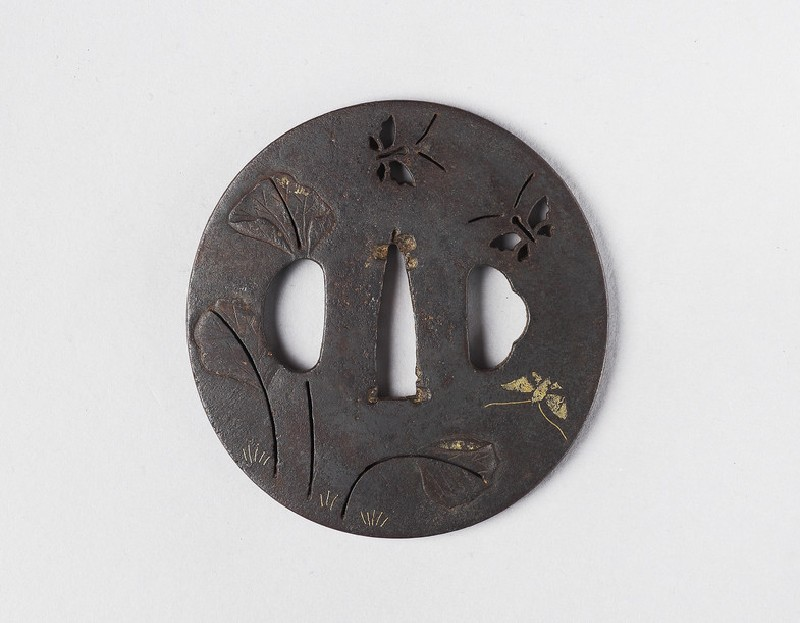Round tsuba with design of butterflies and leaves