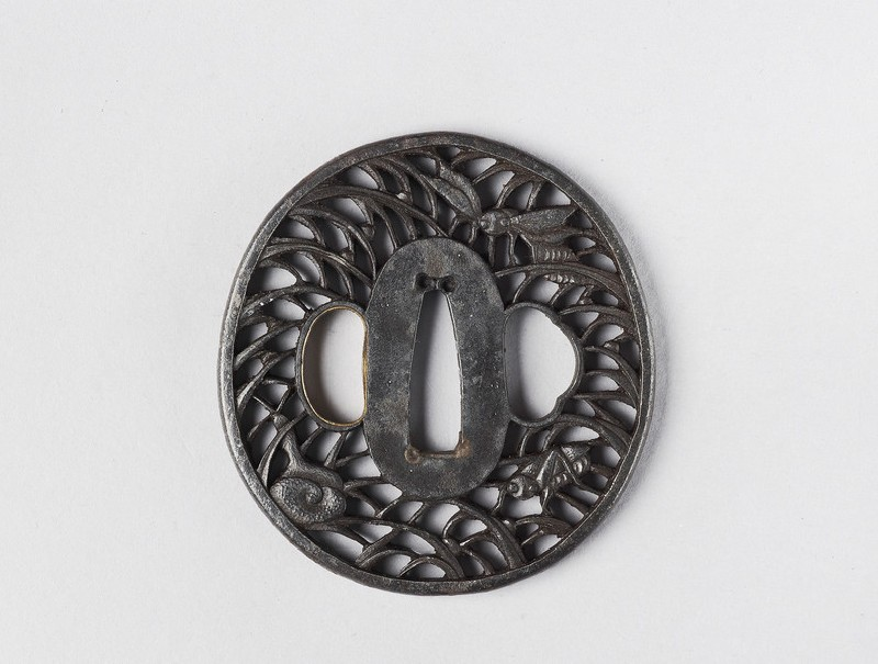 Round tsuba with design of insects and a snail in grass (front            )