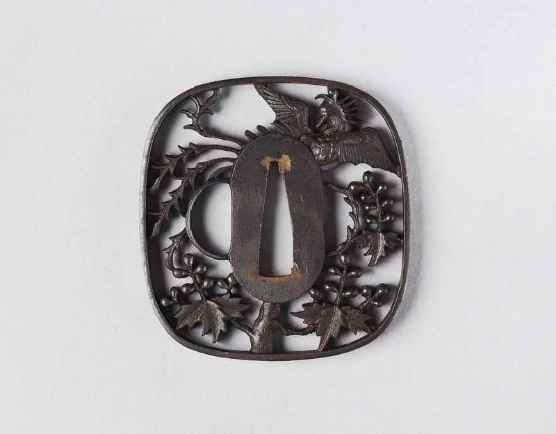 Round tsuba with design of paulownia branches and a phoenix (front            )