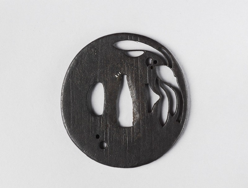 Round tsuba with design of dragonfly