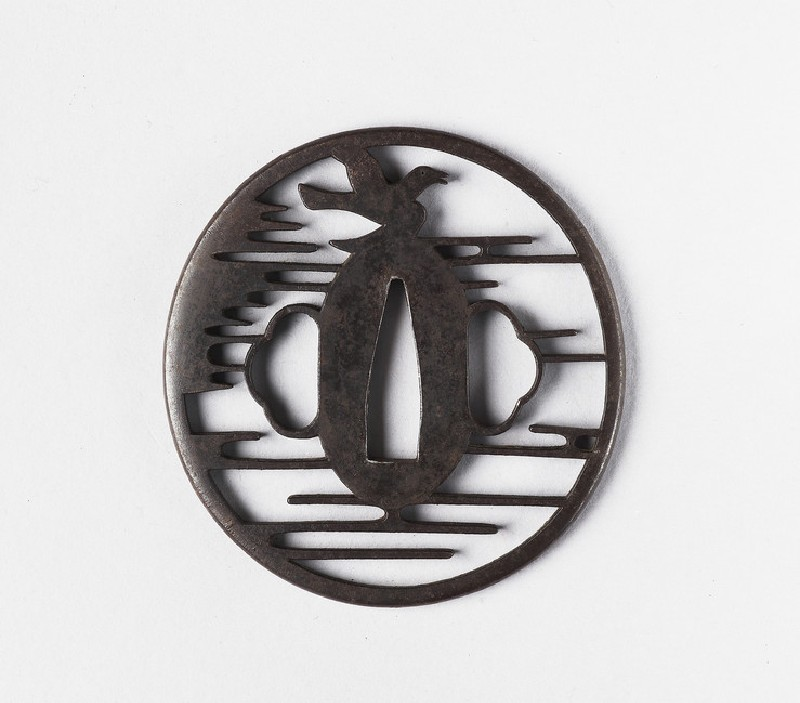Round tsuba with stylised design of clouds and a bird