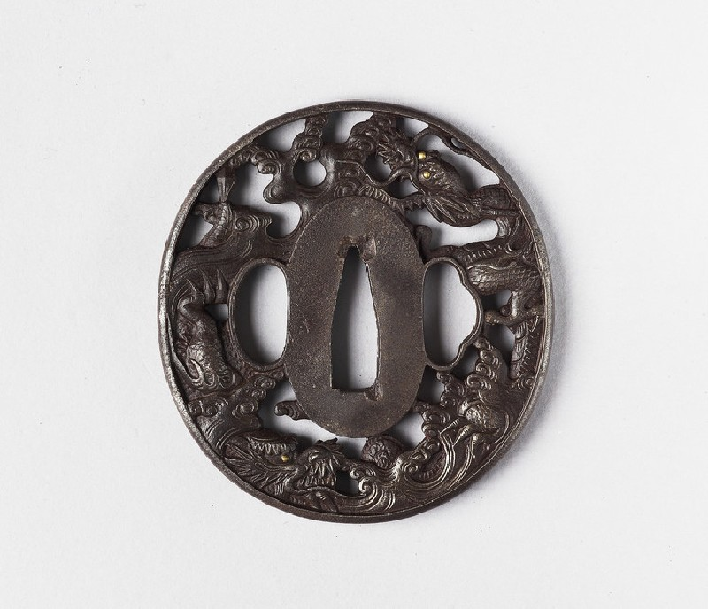 Round tsuba with design of dragons and waves