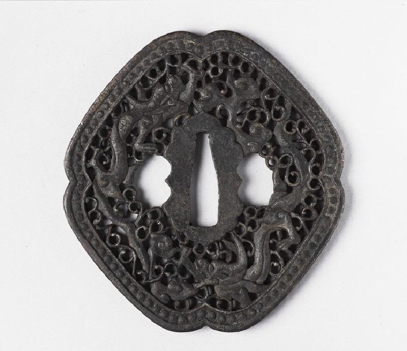 Rhomboidal tsuba with design of dragons and tendrils (front            )