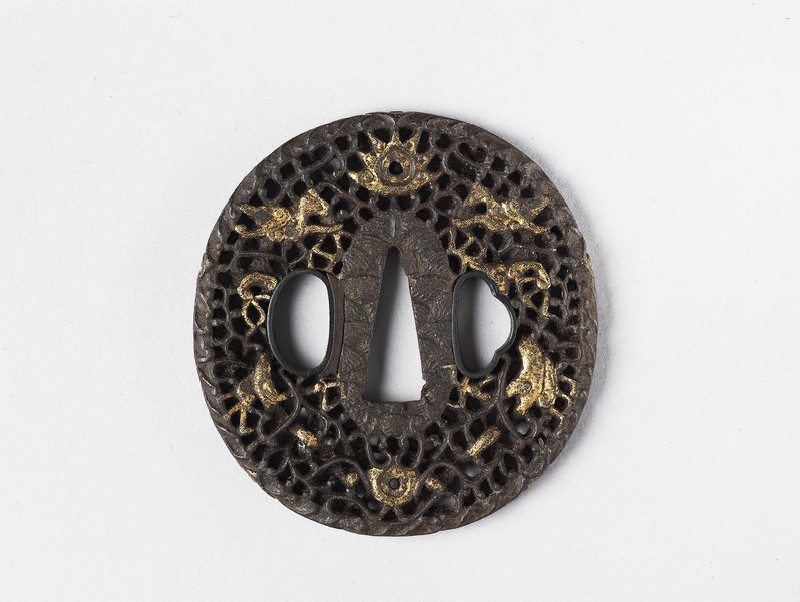 Round tsuba with design of dragons, tama (sacred jewels) and scrollwork (front            )