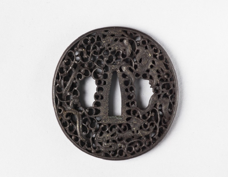 Round tsuba with design of dragons, blossoms and scrollwork (EA1978.308, front            )
