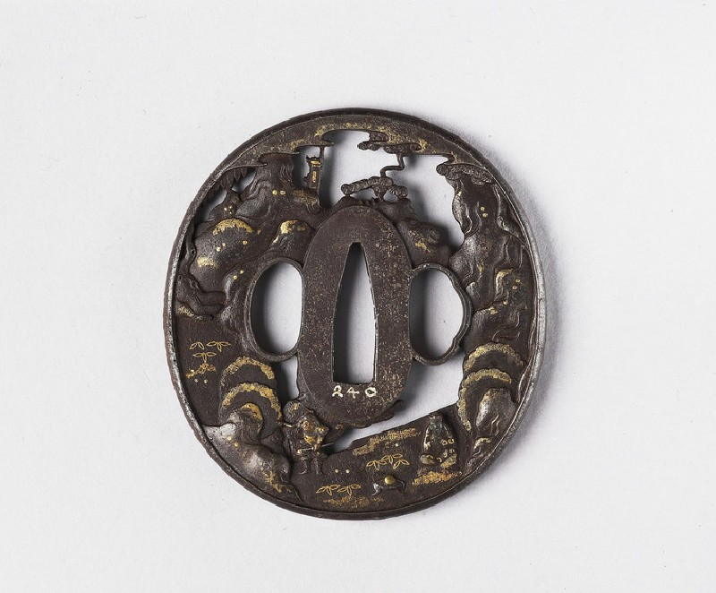 Round tsuba with design of a warrior and sage in mountain landscape (EA1978.310, front            )