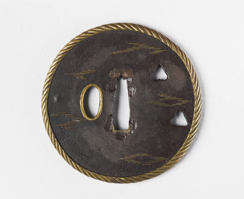 Round tsuba with design of clouds and aoi leaves (EA1978.311, front            )