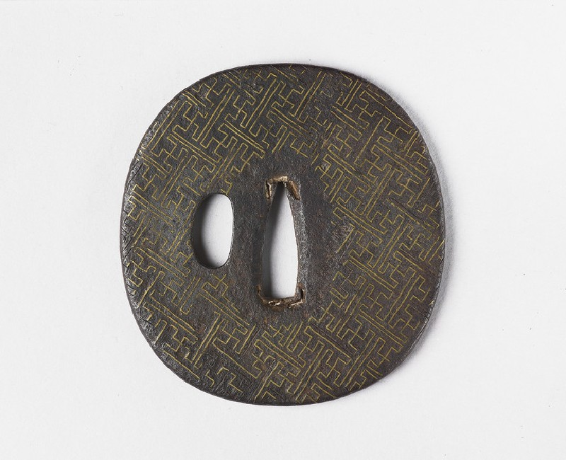 Round tsuba with rinzu, or swastika-fret diaper