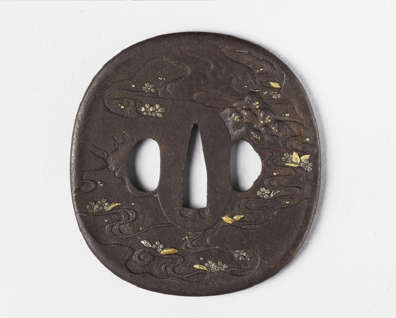 Round tsuba with design of cherry blossoms floating in a stream (EA1978.320, front            )