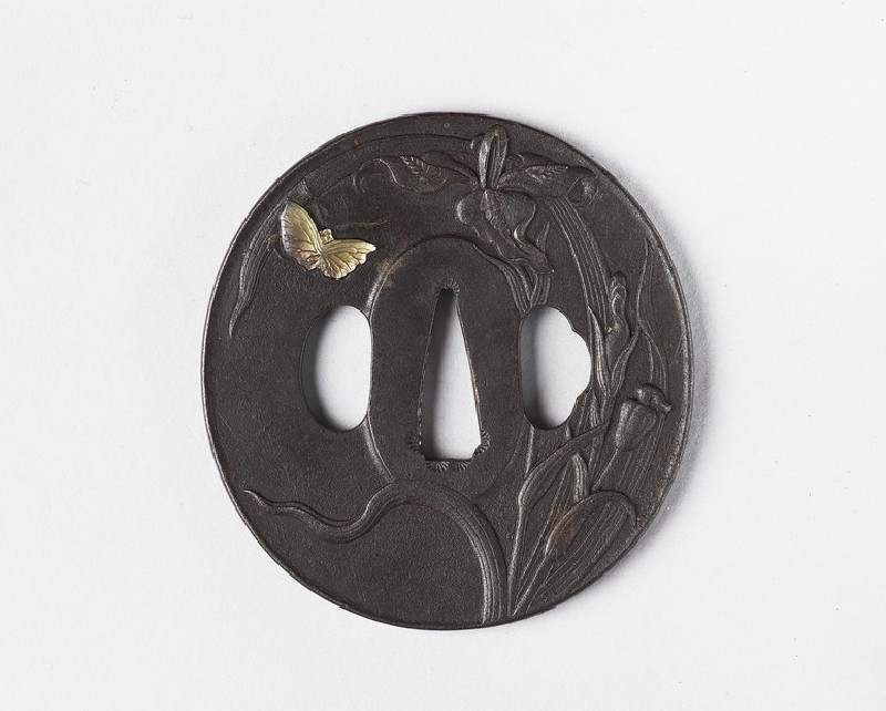 Round tsuba with design of iris and butterfly