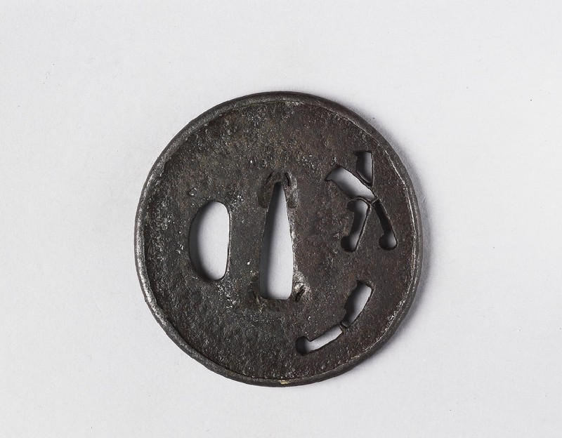 Round tsuba with design of three nata (tools)