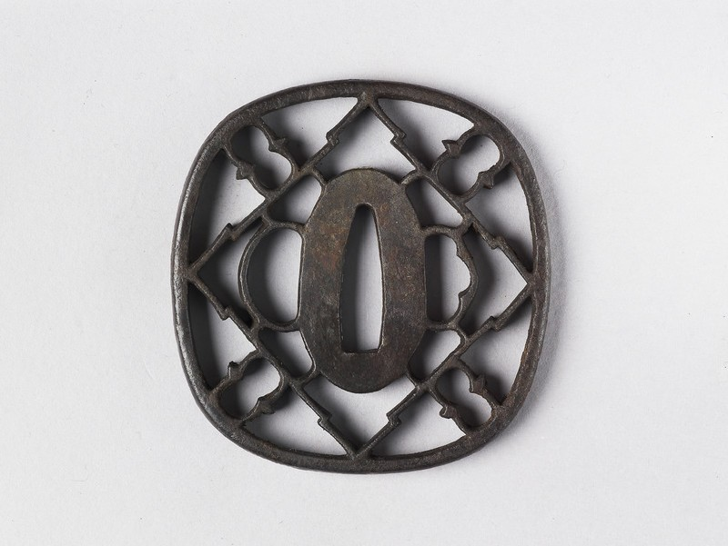Round tsuba with stylised design of geese
