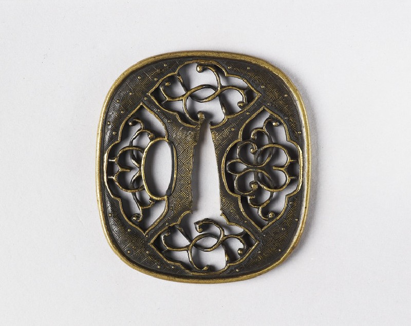 Round tsuba with design of panels and scrolls