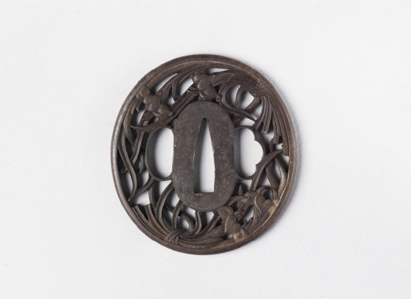 Round tsuba with design of two bunches of irises (front            )