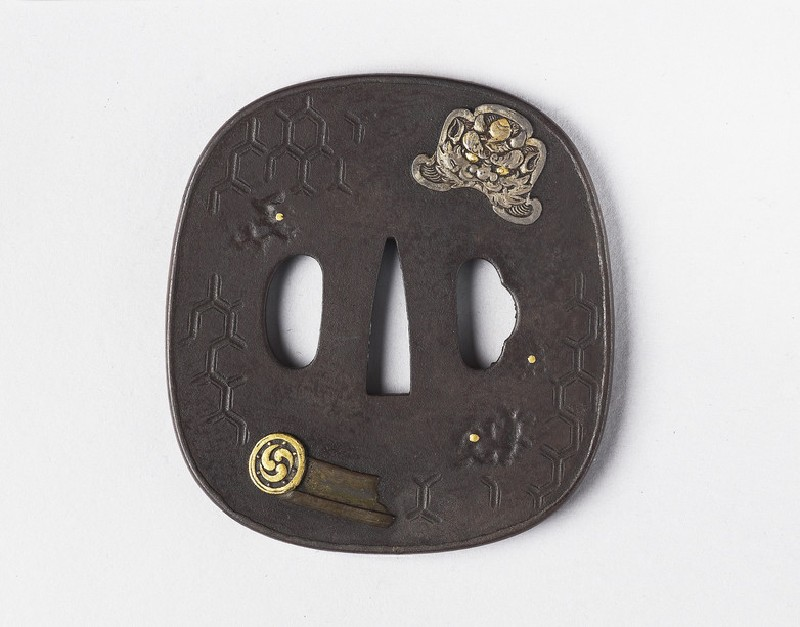 Round tsuba with design of roof ornaments and tiles (EA1978.373, front            )