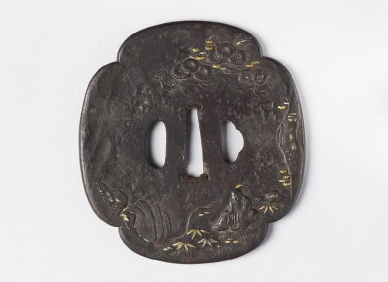 Mokkō-shaped tsuba with design of a sage beside a waterfall (EA1978.382, front            )