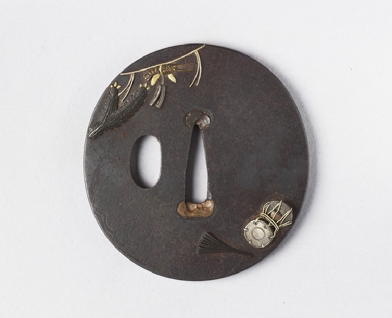 Round tsuba with design of a drum, fan and shimenawa