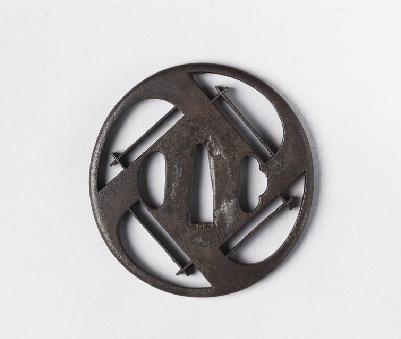 Round tsuba with quadripartite design (front            )