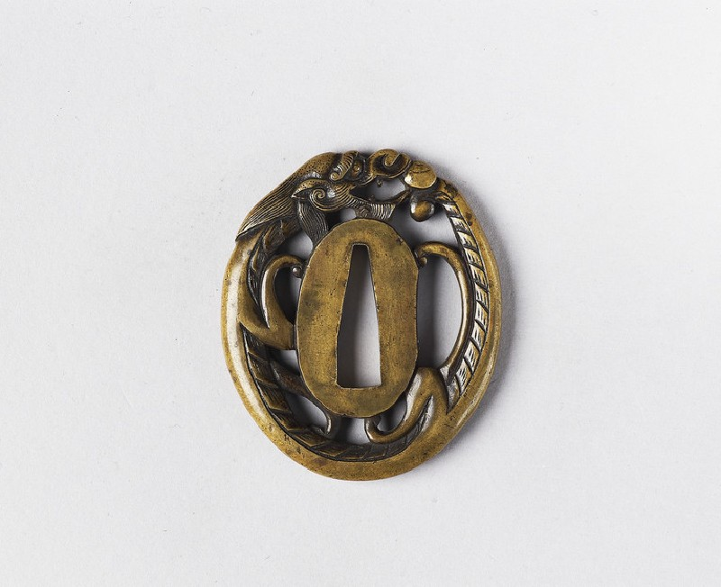 Oval tsuba in the form of a dragon chasing a pearl (EA1978.397, front            )