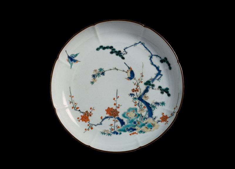 Lobed plate with pine, prunus, and bamboo growing from rocks (front            )