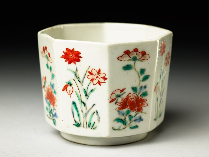 Octagonal cup with peony sprays and flowering plants
