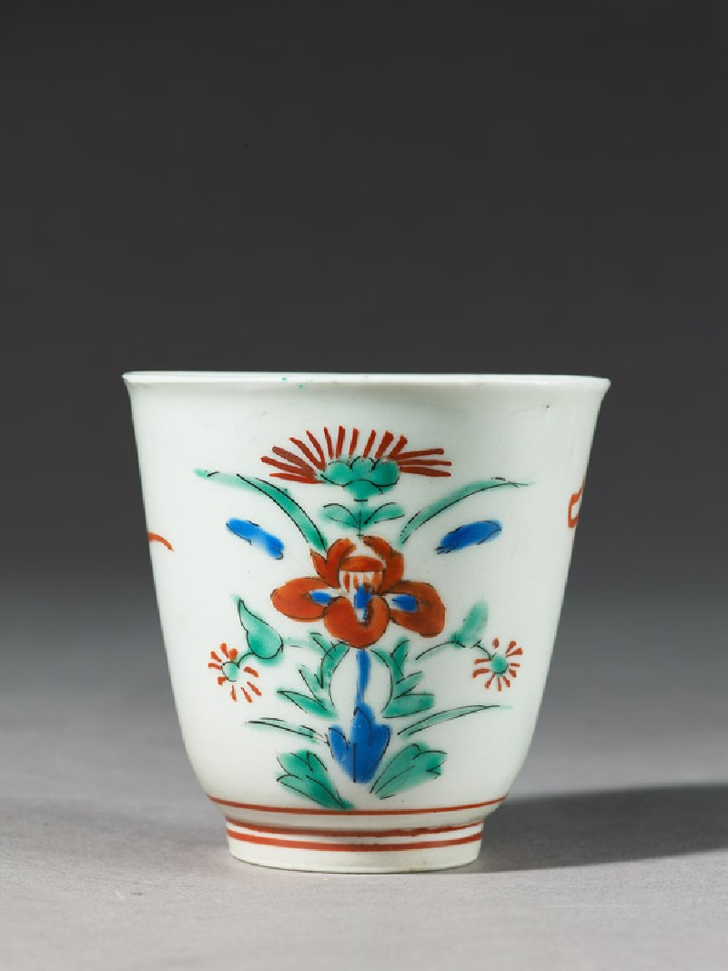 Cup with formal floral design
