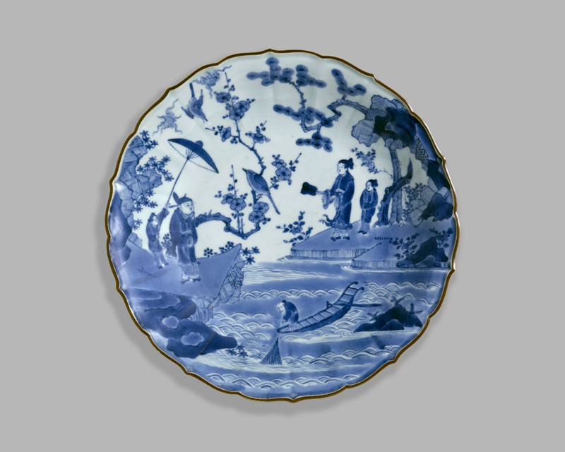 Foliated dish with figures in a landscape