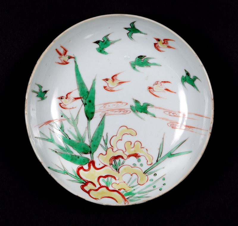 Dish with swallows flying over bamboo