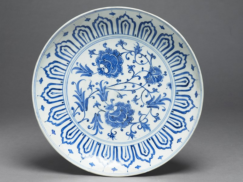 Dish with peony blooms