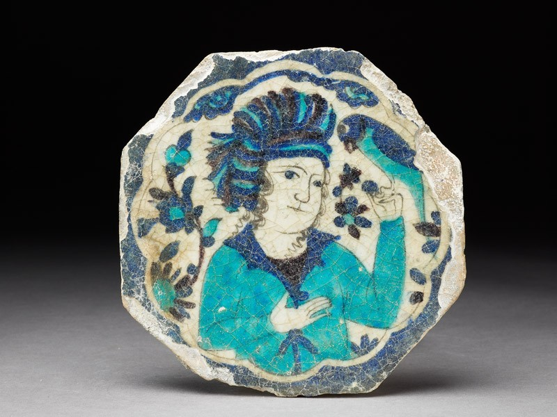 Octagonal tile with turbaned man holding a parrot