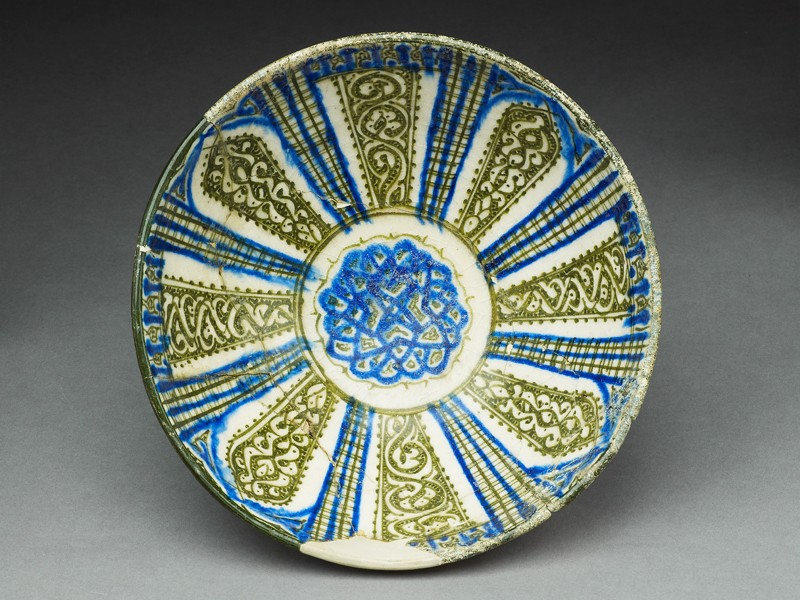 Bowl with vegetal decoration in radial panels (EA1978.1595, top, before conservation             )