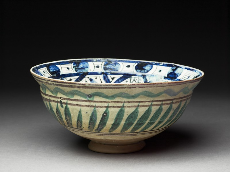 Bowl with central triangle and spiralling panels (oblique             )