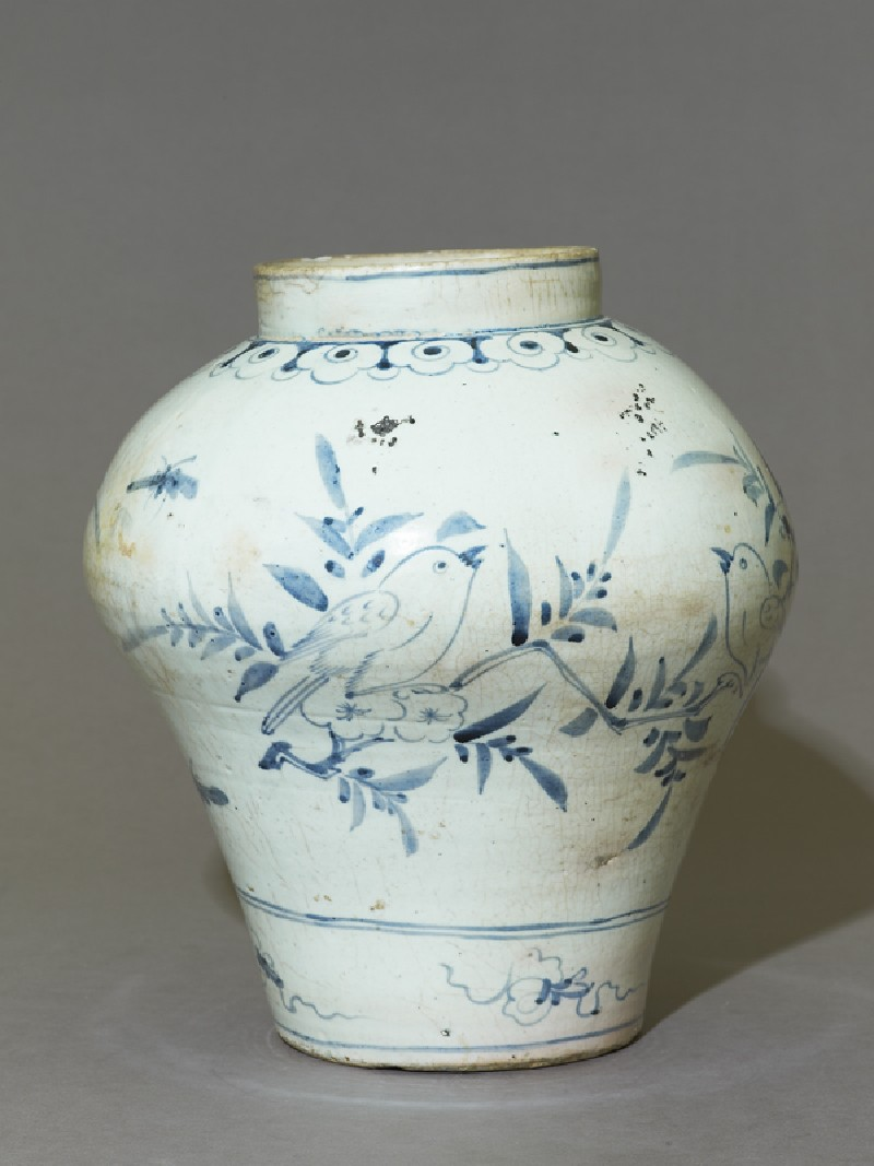 Jar with a bird on a prunus spray
