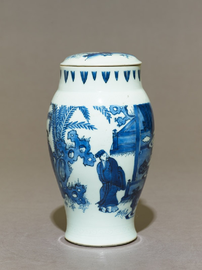 Blue-and-white jar and lid with couple in a garden
