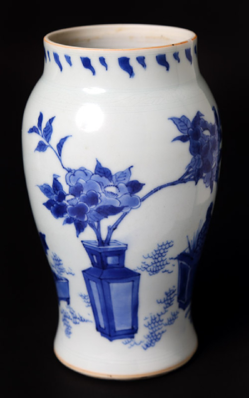 Blue-and-white vase with plants in containers