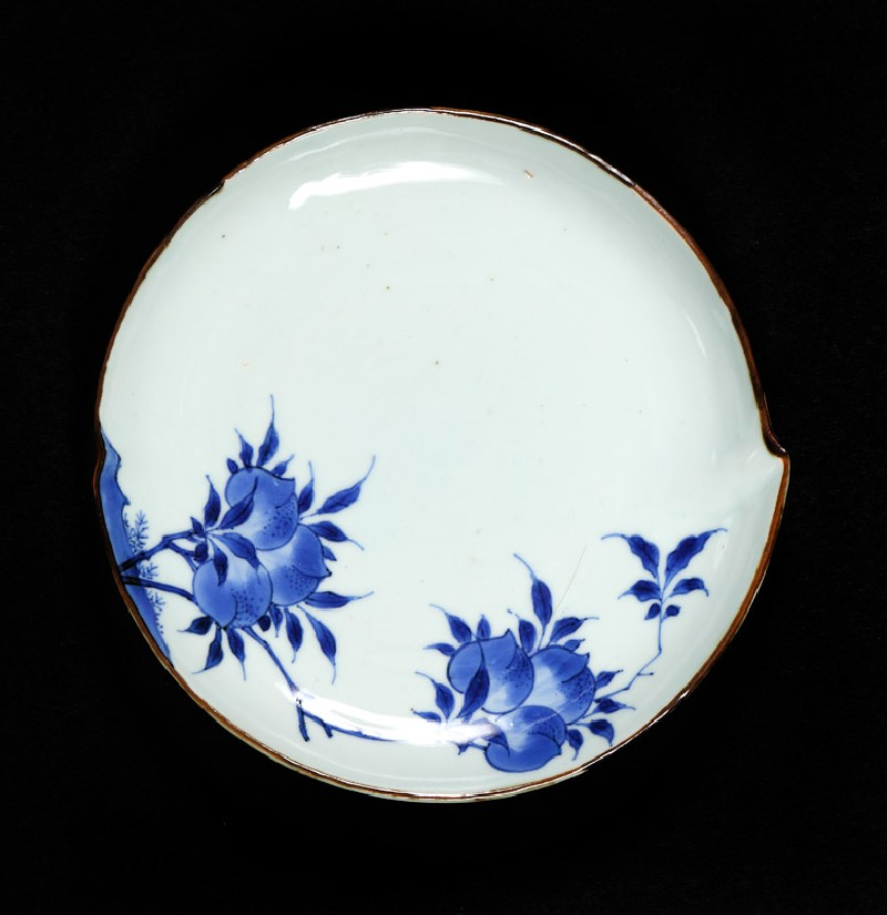 Blue-and-white dish with flowering peach branches